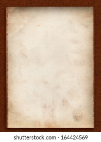 One old photo paper back side grunge with space for text or image  isolated with clipping path on dark brown cardboard background