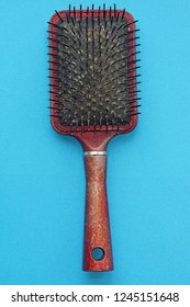 One old used hairbrush with lot of hair