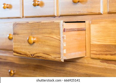 One old wooden drawers opened as seen from the side