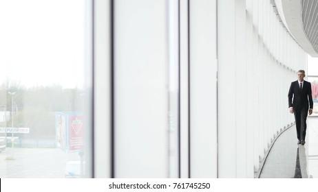 One older man go along window wall