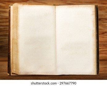 One open blank vintage book on wooden background