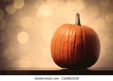 one orange pumpking on background with bokeh lights. Helloween theme
