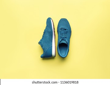 One Pair of blue sport shoes on yellow background