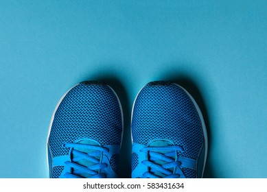 One Pair of blue sport shoes on blue background