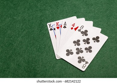 One pair, the second least valuable hand in poker. Two cards of the same value supported by any other three cards.