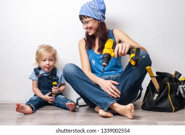 One parent: Mom performs men's housework with a small daughter and sat down to rest at the white wall.