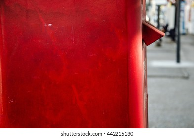 one part of red post box set against a de-focused thailand