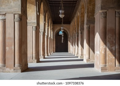 One of the passages surrounding  the courtyard of the Mosque of Ahmad Ibn Tulun framed by huge decorated arches, old Cairo, Egypt