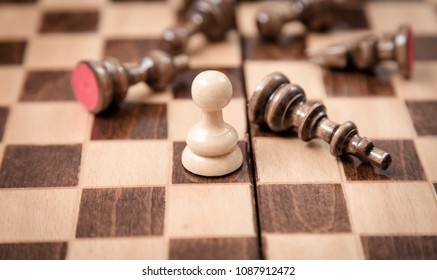 One pawn staying against full set of chess pieces..