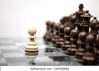 One pawn staying against full set of chess pieces. Creative success business concept meaningful photo of one pawn staying against full set of chess figures pieces on board.
