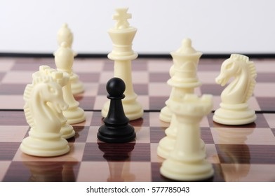 One Pawn Staying Against Set of White Chess Pieces