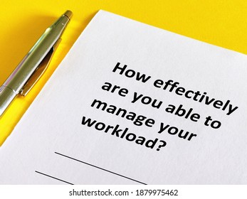 One person is answering question.He is thinking how effectively is he to manage his workload.
