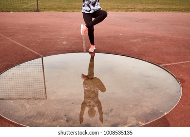 one person exercise, sport clothes, tights, puddle reflection in water, Single-Leg Squat