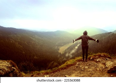 One person feel freedom in beautiful mountains scenery.