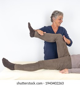 One person tests a Touch for Health (kinesiology) muscle in the other person.