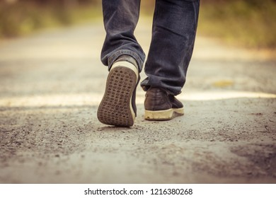One person walking on the road