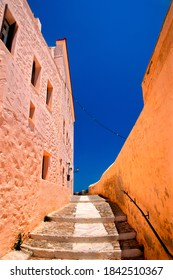 """One of  the picturesque alleys of Ano Syra (""""Ano Syros""""), the old medieval settlement of Syros island, Cyclades, Aegean sea, Greece."""