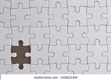 One piece missing white jigsaw puzzle