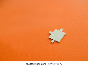 One piece puzzle jigsaw on orange background.