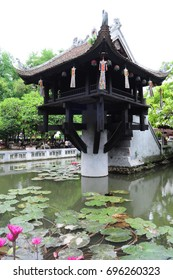 One Pillar Pagoda in the lake with lotus plants