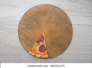 one pizza piece on board isolated