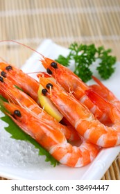 one plate of shrimps with green vegetables