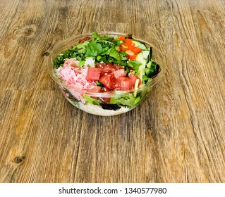 One Poke Bowl with Ahi Tuna Salmon Salad Greens and Rice Top View on Wooden Table