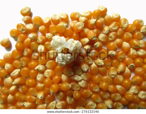 One popped kernel stands out from the crowd in this popcorn image