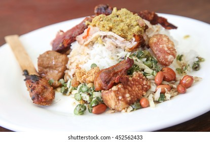 One portion of roasted pig with rice -  one of Baliâ??s most famed dishes.