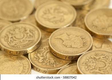 One Pound coins arranged on a  white background