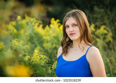 One Pretty Caucasian High School Senior Girl Wearing Blue Tank Top