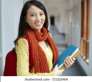 one pretty Chinese asian college student smile at camera in campus