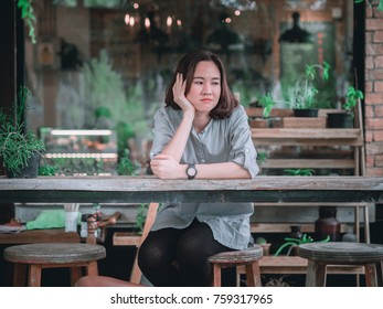 One of pretty woman sitting in coffee shop with relax action