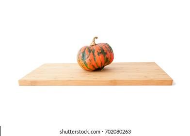 One pumpkin on a bamboo board