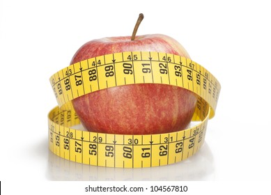 one red apple surrounded by a tape measure