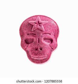 One Red Army Skull, Ecstasy, MDMA or medication pill shaped like a skull isolated on a white background.