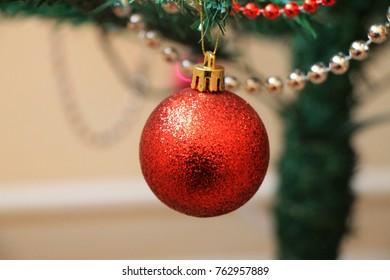 One red Christmas ball on christmas tree