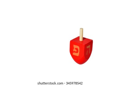 One Red Dreidel (sevivon) spin. It is a four-sided spinning top, played with during the Jewish holiday of Hanukkah. Holiday concept with copy space