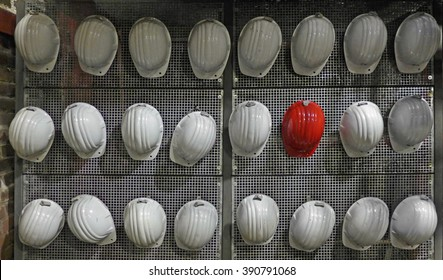 One red helmet among white ones