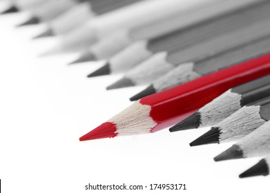 One red pencil standing out from others