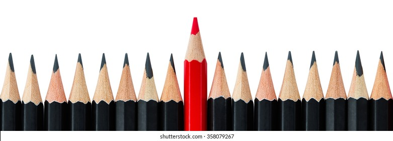 One red pencil standing out from the row of black pencils. Letter box format