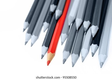 One red pencil standing out from dull pencils