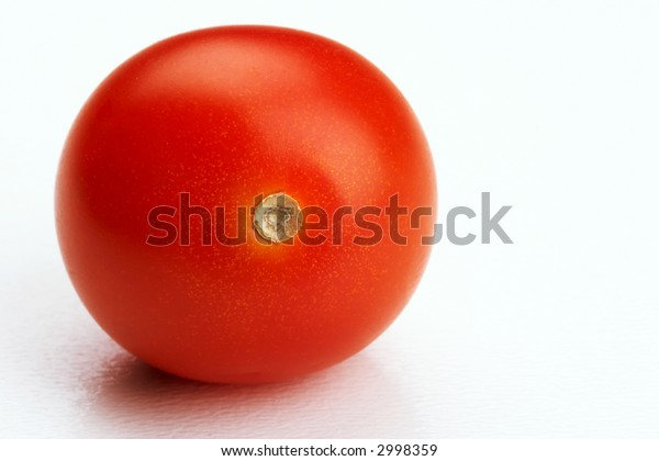 One red Tomato on white background - landscape format