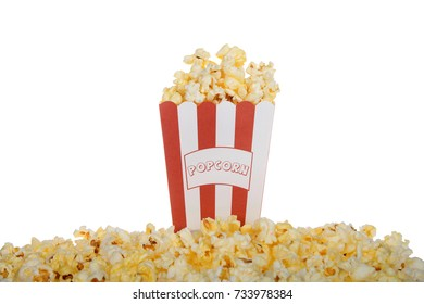 One red and white stripped bag labeled POPCORN filled with fresh butter popcorn with the same spilling over pilled in front of the bag isolated on a white background.