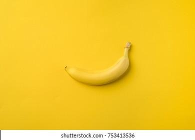 One ripe banana isolated on yellow