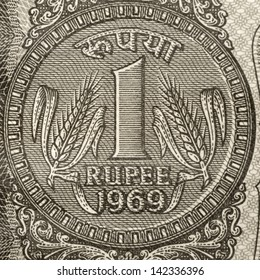 One rupee coin symbol on the note