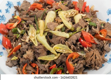 One of Sabah traditional local food. Stir fry Spilt Gill Fungus with white chillies, red chillies, local onion and anchovies.