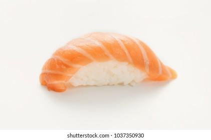 One salmon nigiri sushi isolated on white background. Japanese cuisine, copy space