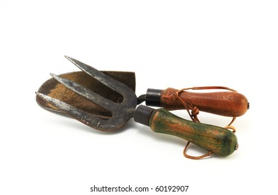one of a series of old garden tools on white background with room for copy