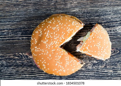 one sesame bun stuffed with meat, cheese, and herbs and other ingredients, inexpensive fast food , closeup unhealthy food